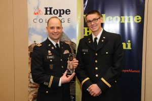 Jeremy Latchaw '00 after receiving a 2015 Hope College Young Alumni Award. Jeb Wierenga, a Hope ROTC student, presented the award.