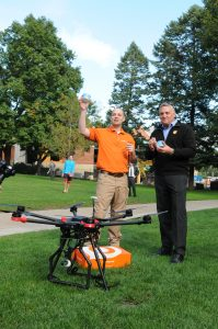 Jeremy Latchaw '00 and OrangeLeaf President Geoff Goodman celebrate a successful landing.