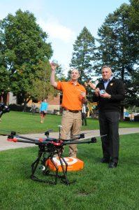 Jeremy Latchaw '00 and OrangeLeaf President Geoff Goodman celebrate a successful landing.