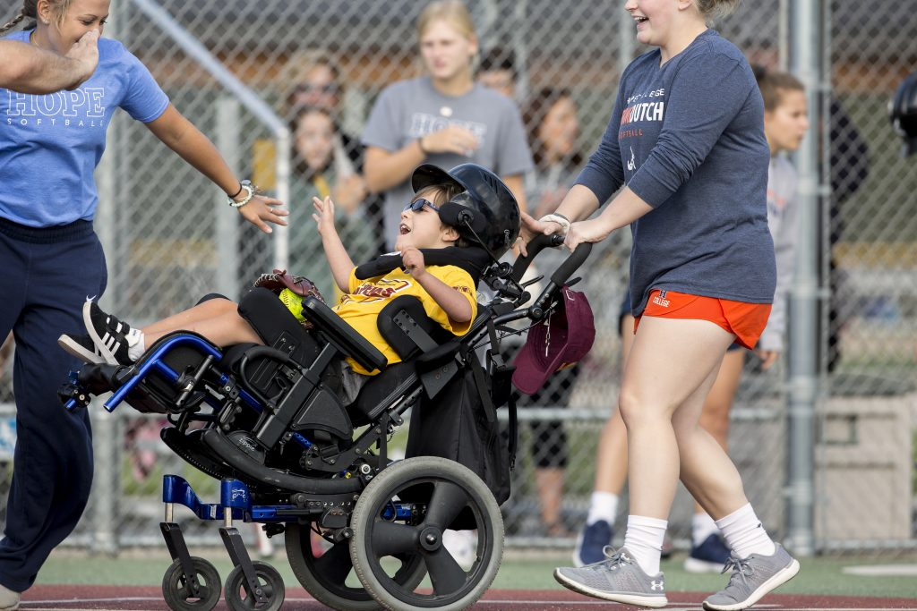 An WMML player in a wheelchair scores a run