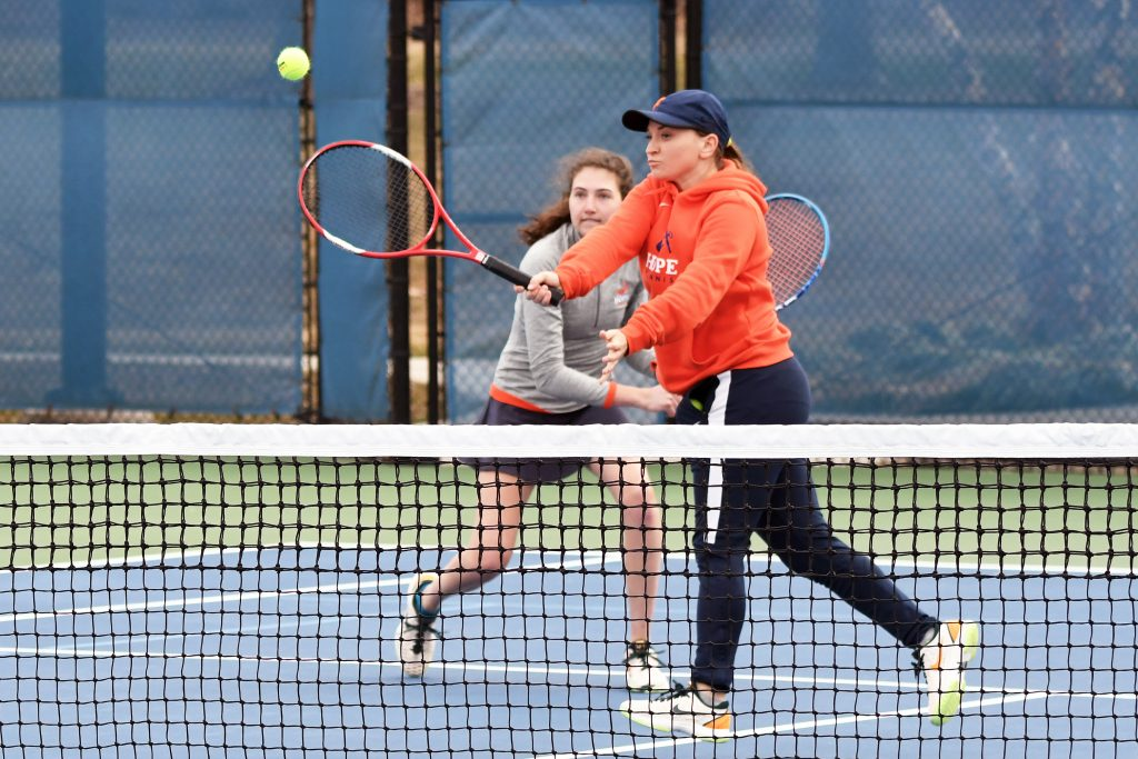 Claire Hallock and Amanda Bandrowski playing doubles tennis