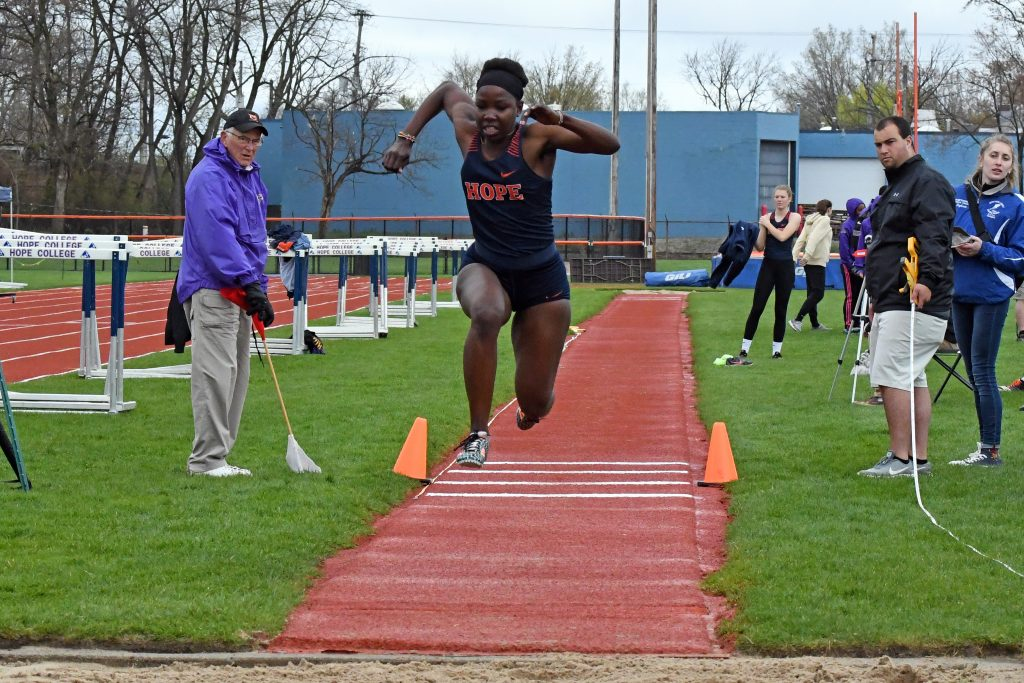 Mitchel Achien'g leaps to compete in the triple jump
