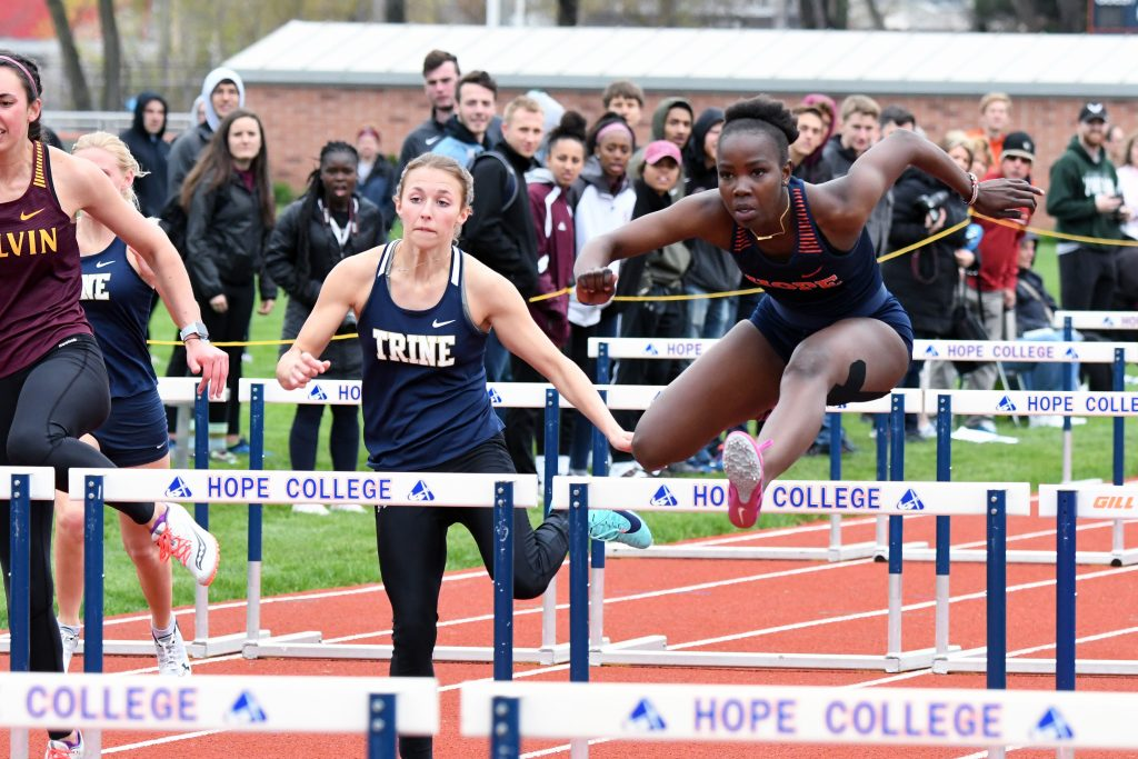 Mitchel Achien'g clear a hurdle in a race.