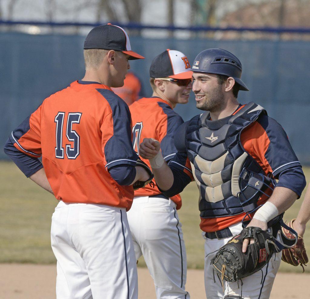 Trace Slancik offers congrats after a baseball.