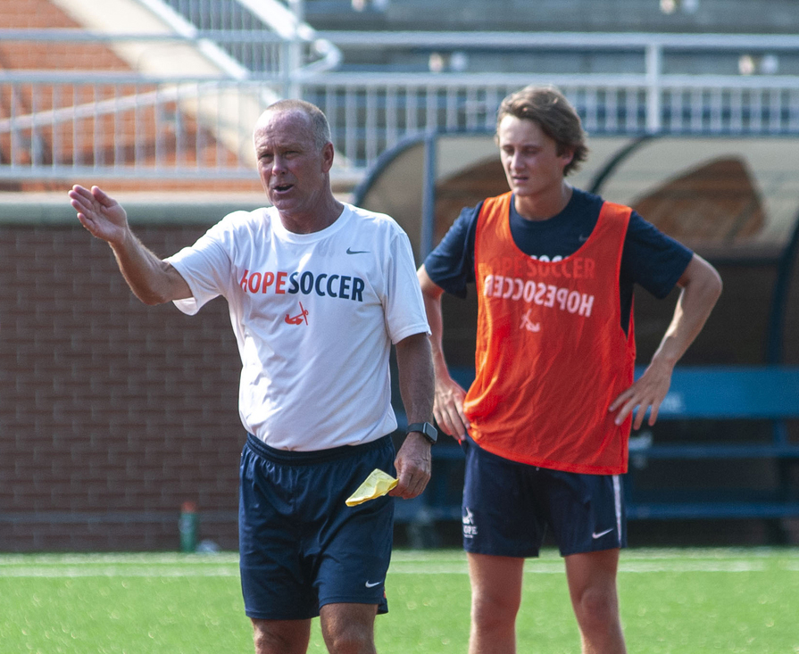 Head coach Dave Brandt points his right hand while instructing his team during practice at Van Andel Soccer Stadium.