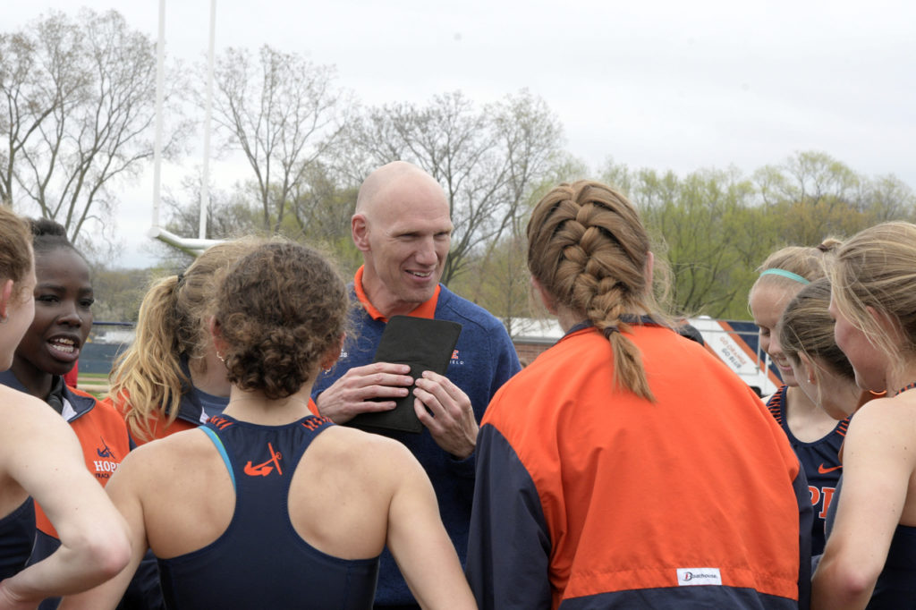 Hope College track and field coach Kevin Cole talks with his team during the 2019 MIAA Outdoor Championships.