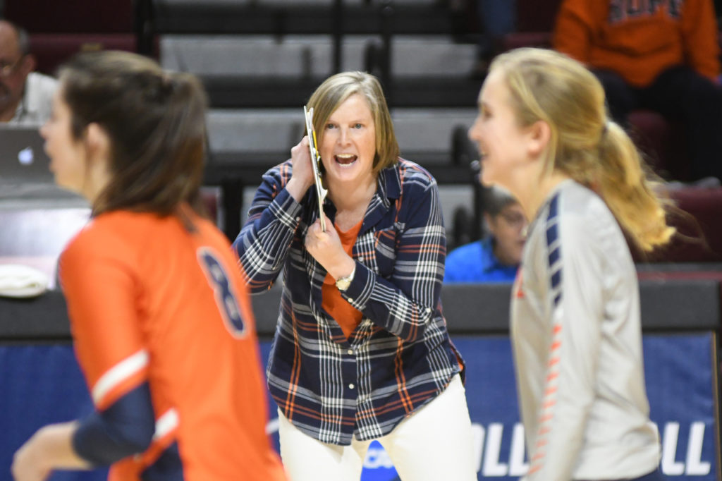 Hope College volleyball coach Becky Schmidt shouts instructions from the bench during a 2019 NCAA Tournament game.