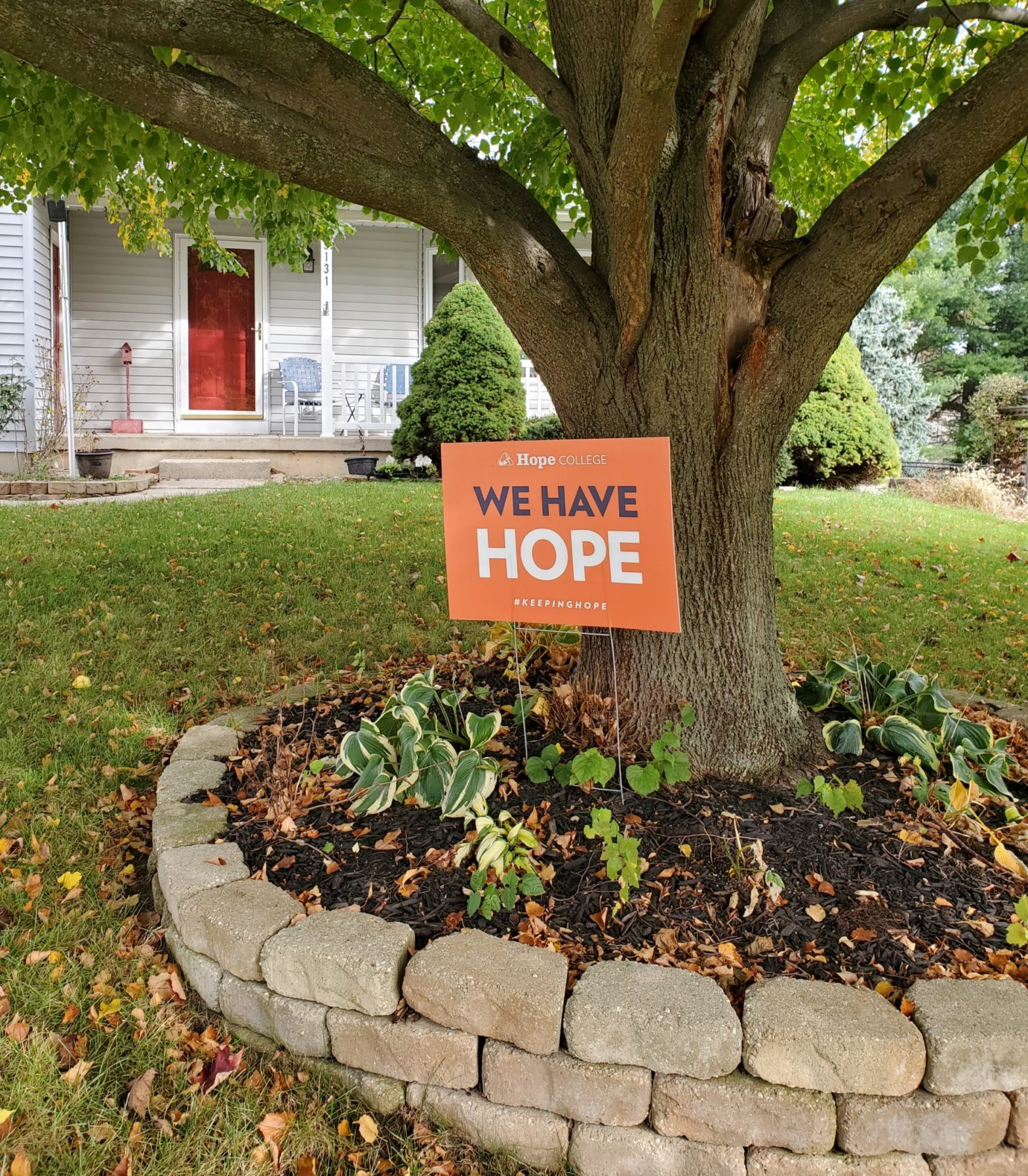 We Have Hope yard sign in a front yard of a home.
