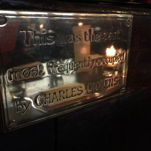 3) The Dickens' nameplate in Ye Olde Cheshire Cheese pub in London.
