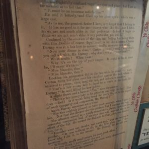 4) The copy of A Tale of Two Cities hanging on the wall near the Dickens' seat in Ye Olde Cheshire Cheese pub.