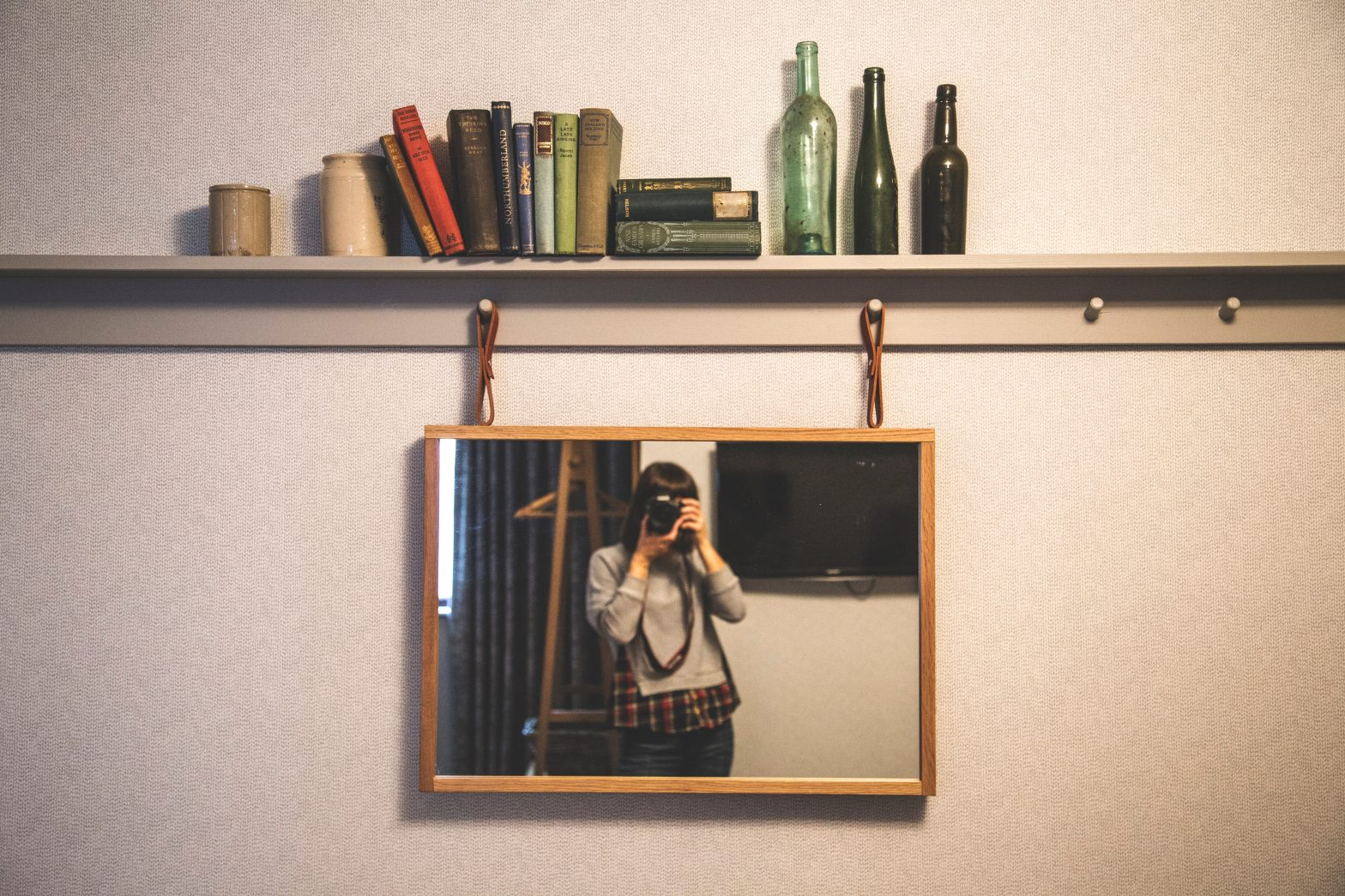 Photographer pictured in a mirror
