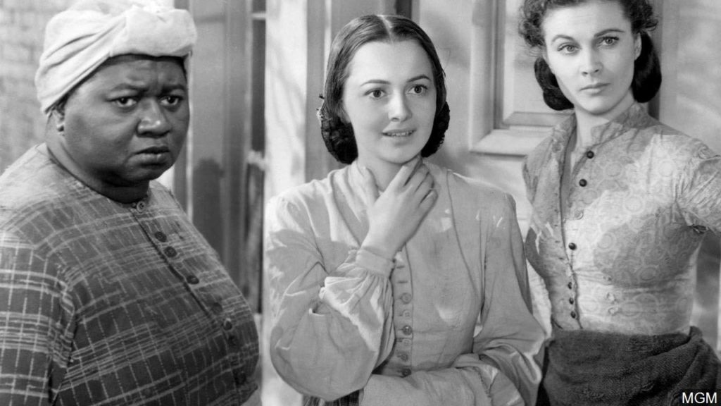 """Gone with the Wind (1939) included the great Hattie McDaniel as """"Mammy."""" She won an Oscar for this performance becoming the first African-American to win the award. She had to sit at a segregated table on the side of the room at the awards."""