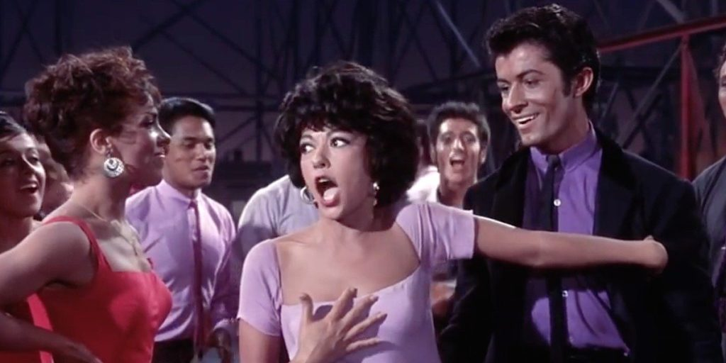 Rita Moreno in West Side Story (1961). She won the Academy Award for this role and is one of the few artists to win all four major annual American entertainment awards: an Emmy, a Grammy, an Oscar and a Tony.