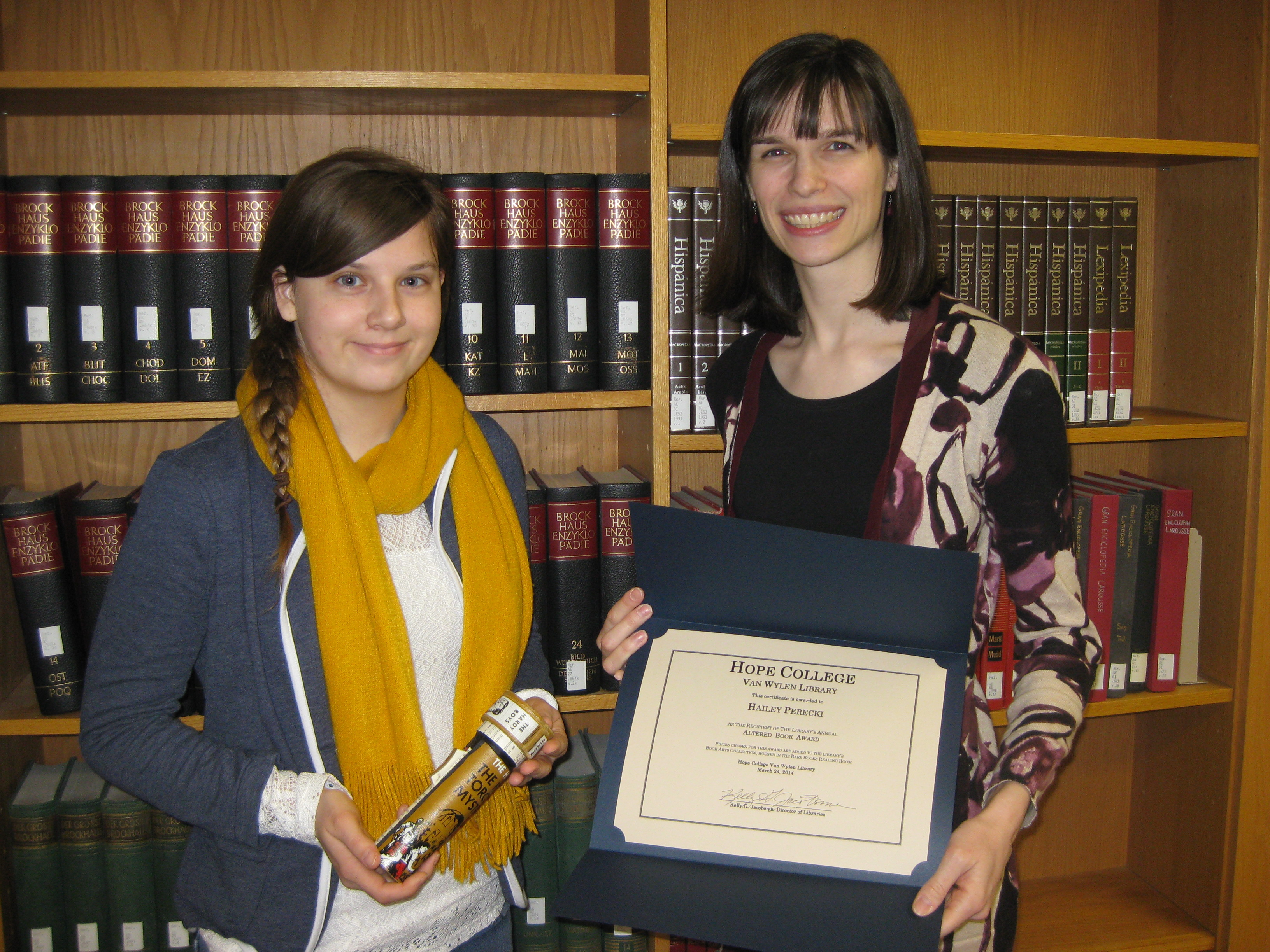 Hailey Perecki, winner of this year's Altered Book Art Award, with librarian Jessica Hronchek.