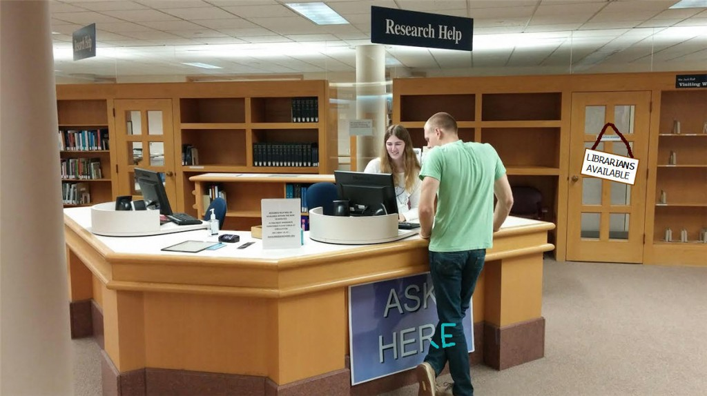 A student employee of the Van Wylen Library helps her peer find the right resource.