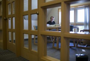 student working in study room on 3rd floor of the library