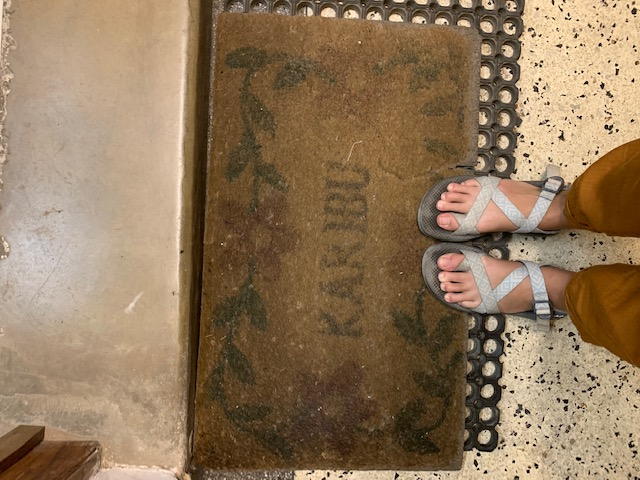 "A door mat with the word ""Karibu"" meaning welcome!"