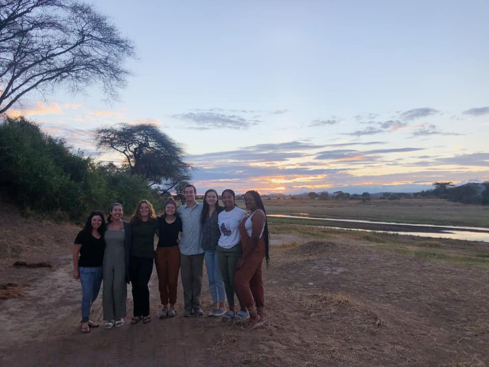 Group photo with the sunrise!.. and the only time we were allowed to get out of our safari cars!
