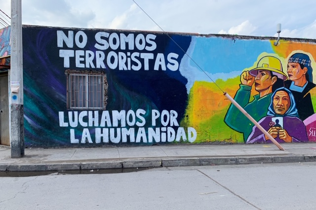 A mural from the side of a building; translation: We are not terrorists, we fight for humanity.