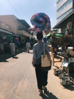 Trying to carry a mattress through the market on my head like a true Tanzanian! It stayed for less than 3 seconds... I need some practice!