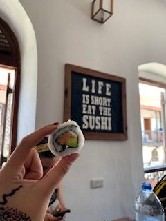 "The sign says it all!  ""Life is short, eat the sushi"""