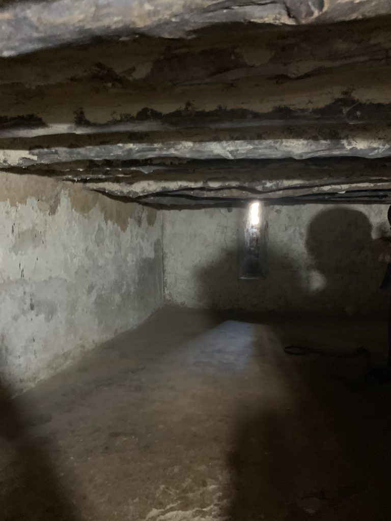 If you look closely you can see chains that have been preserved... that small light was the only opening of fresh air for 50 people. A moving and chilling experience.