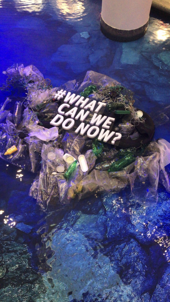 "A display of trash littered in water that says ""What can we do now?"""