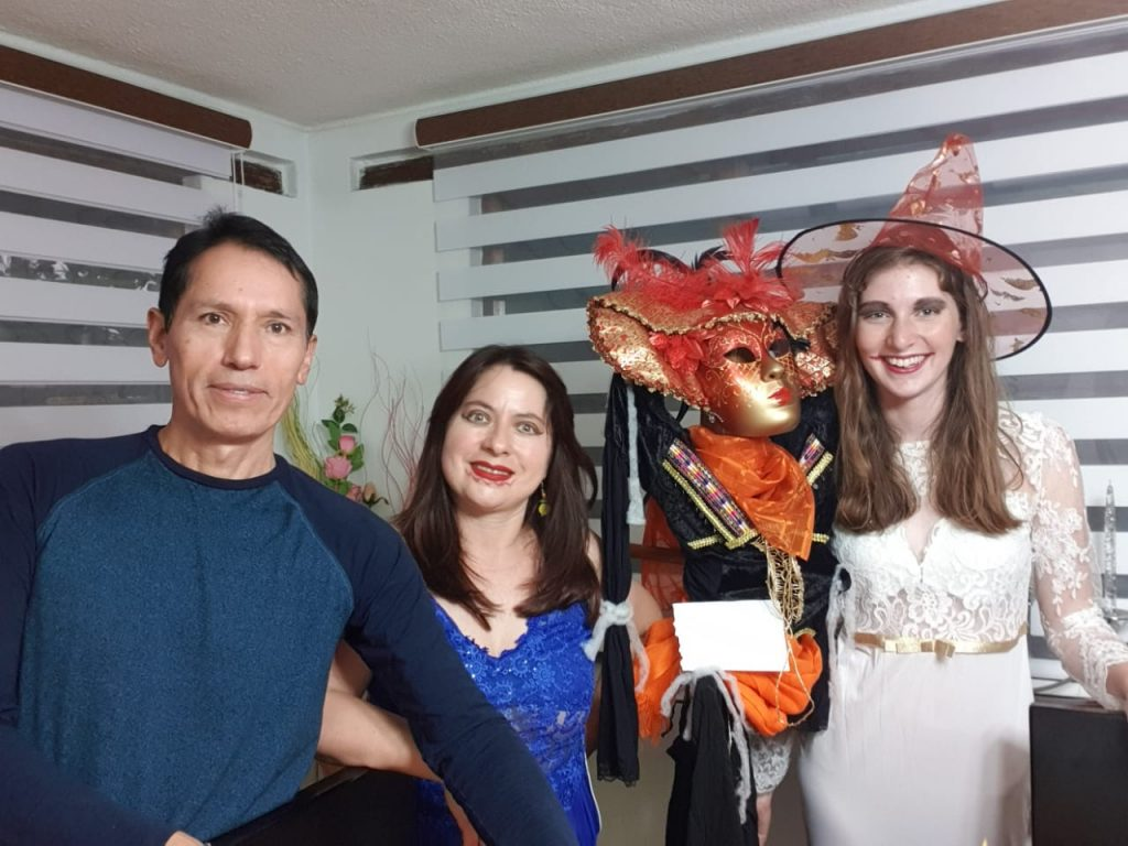 My host parents and I all dressed up for Halloween