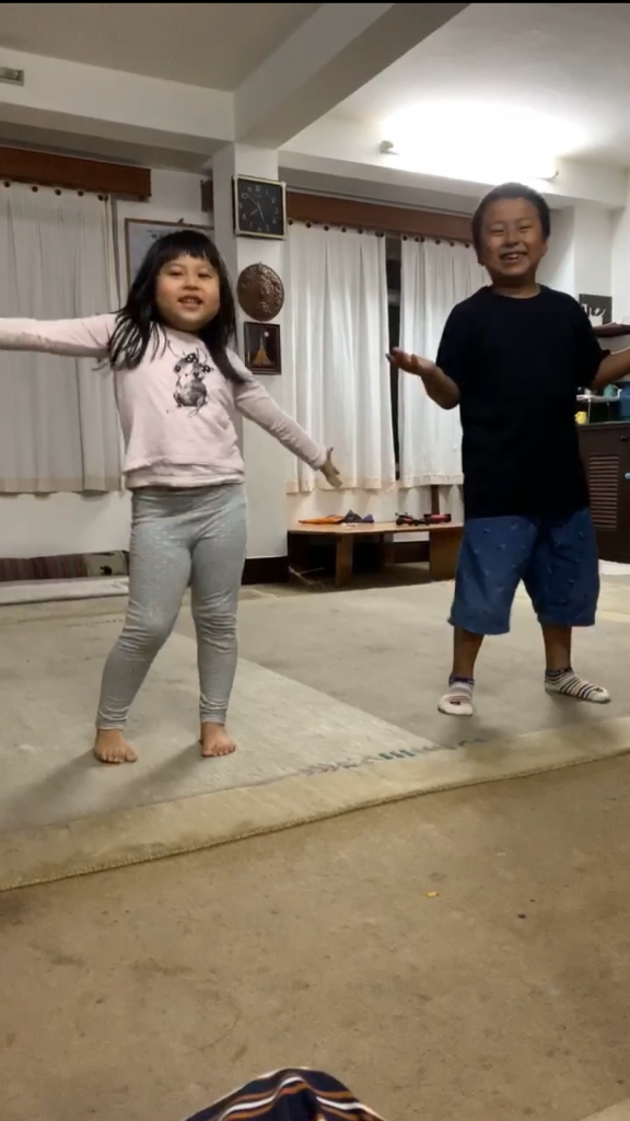 My host siblings singing and dancing for us.