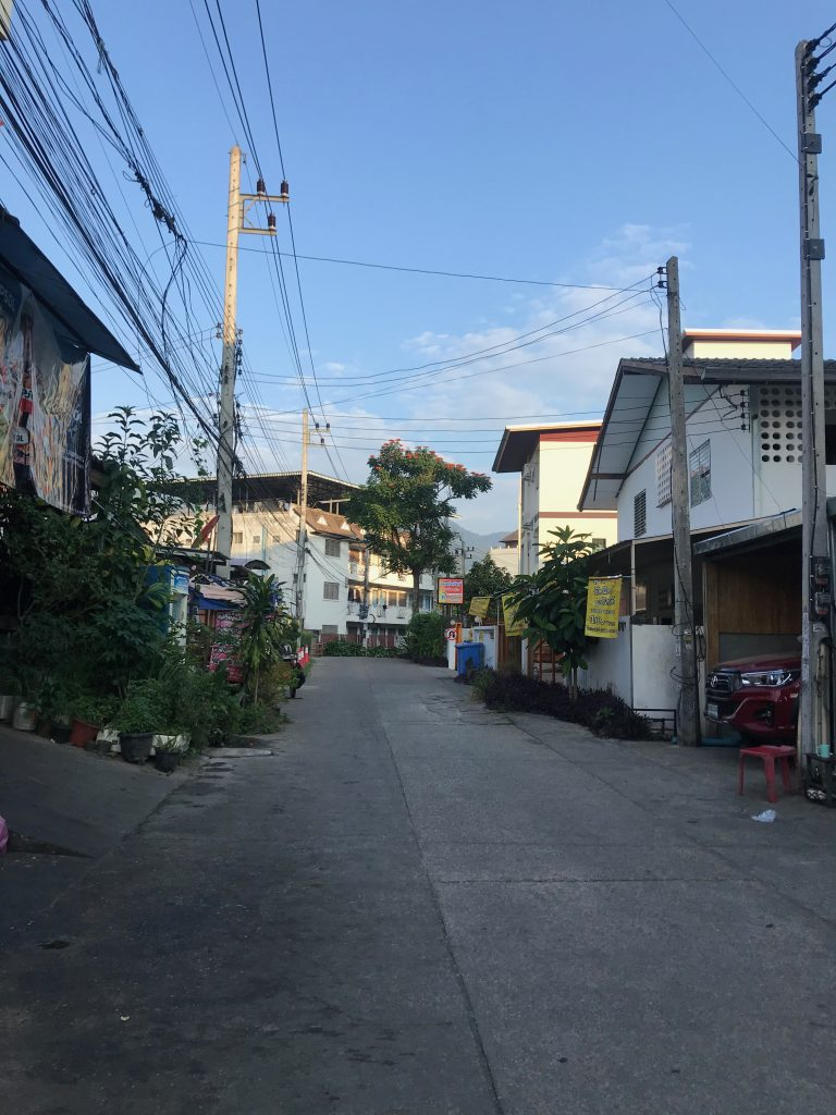 Walking down a peaceful side street off of Soi 7