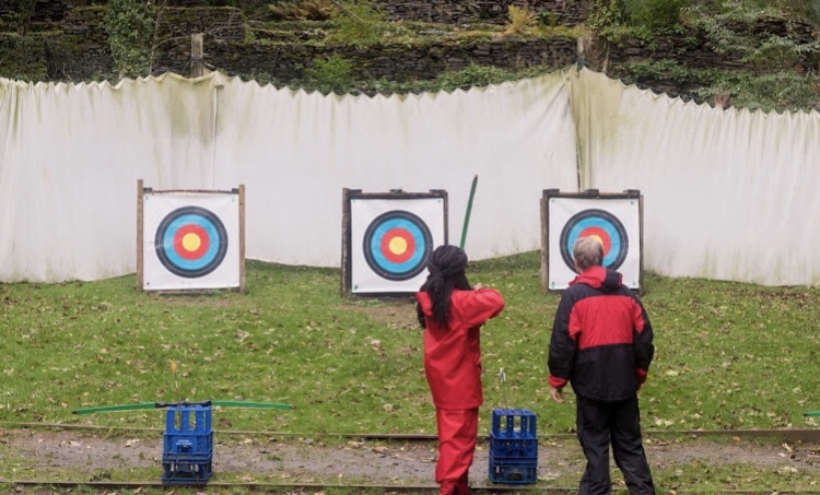 Me aiming at a target during archery.