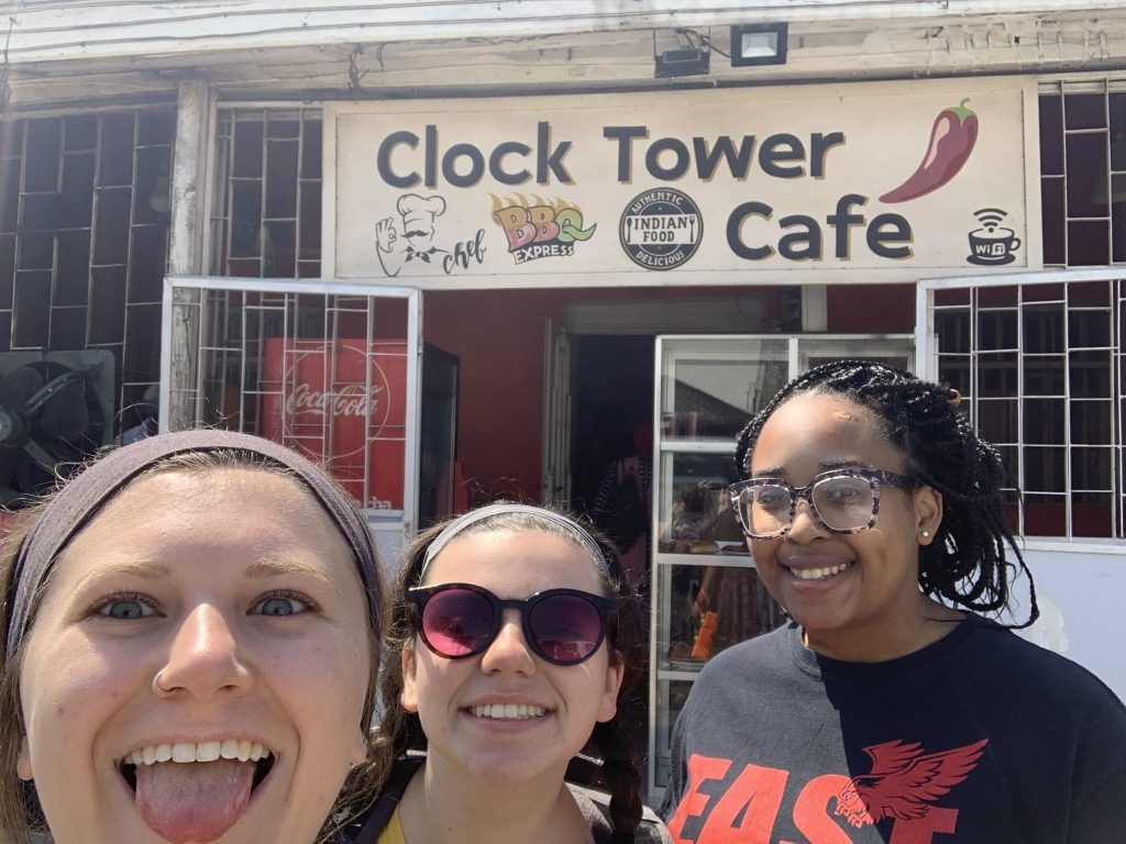 Me, Ellie, and Lyric posing in front of clocktower during a scavenger hunt!