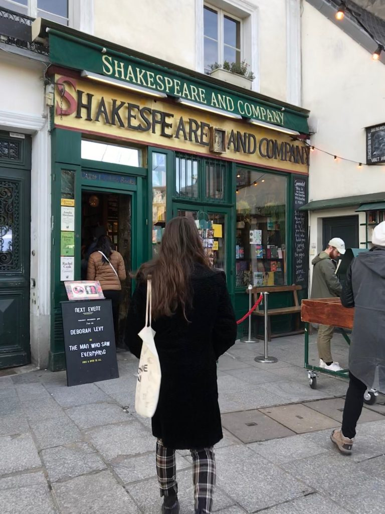 Walking into my favorite bookstore, Shakespeare and Company.