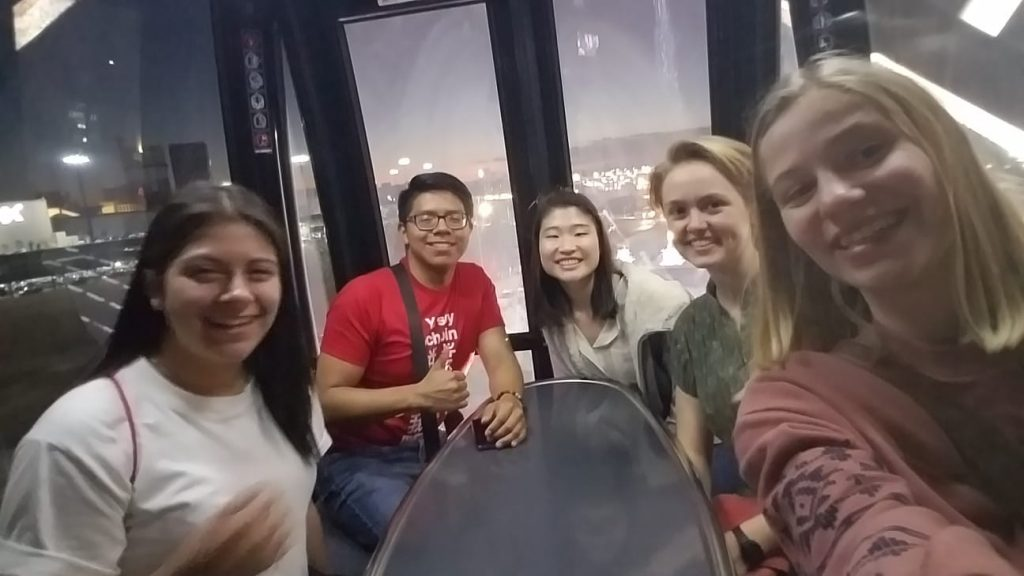 The orientation leader, Nacho, and some of the neighborhood girls in a Ferris wheel