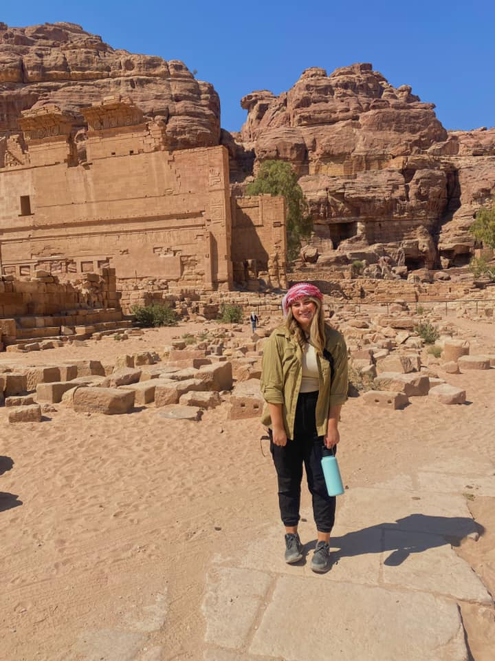 """Across Petra you'll find small vendors inviting you to take a look at their souvenirs. It's a full-time job saying """"La shukran,"""" which means """"No, thank you"""" in Arabic, every 30 seconds. I did however say """"Aywa,"""" or """"yes"""", once when I bought a traditional Jordanian keffiyeh. These scarves are square and made of cotton, worn predominantly by Palestinians and Jordanians, particularly males. A red keffiyeh, like mine, is indicative of Jordanian history, whereas a black and white scarf is indicative of the Palestinian fight and ongoing struggle. As it turns out, they are also extremely functional, preventing sunburn and allowing for a perfect face covering when the sand blows."""