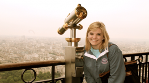 Visiting the Eiffel Tower while studying in Paris.