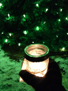 My candle and the lit Christmas tree.