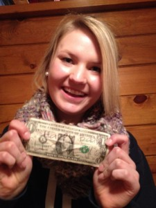 "Audrey wrote ""Happy Birthday"" on a dollar that was hung up at the restaurant"