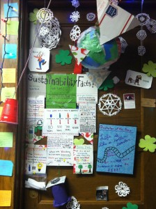 """Our Sustainability Facts & Tips poster complete with a """"share your own green living ideas"""" jar AND a globe that my lovely roommate made and hung up."""