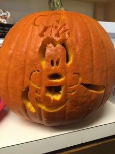 Pumpkin with Disney's Goofy carved in it.