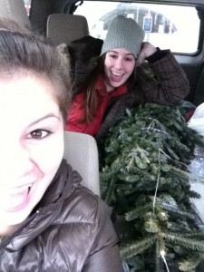 This is a picture of my sister and myself with our live Christmas tree a few years ago!