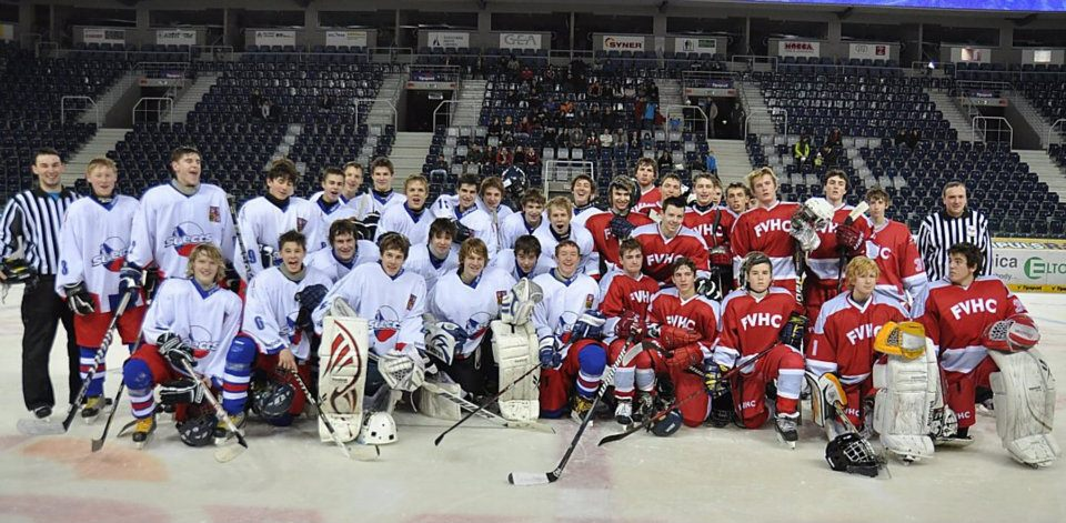 This is where my two lives connected. My U.S. hockey team (red) traveled to my hometown in the Czech Republic and played my former Czech team ( white).
