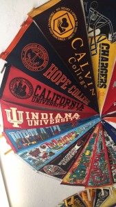A circle of college pennants including Hope College and Calvin College.