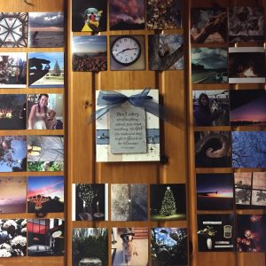 Philippians verse on wall surrounded by pictures.