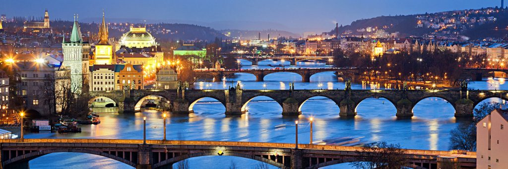 Scenery of Prague: River Vltava and National Theater (building on the left with the with the lights around)