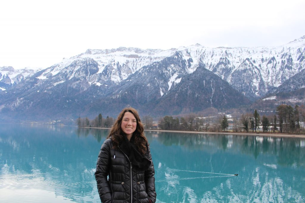 Me standing in front of Lake Brienz with the Swiss Alps snow covered in the background