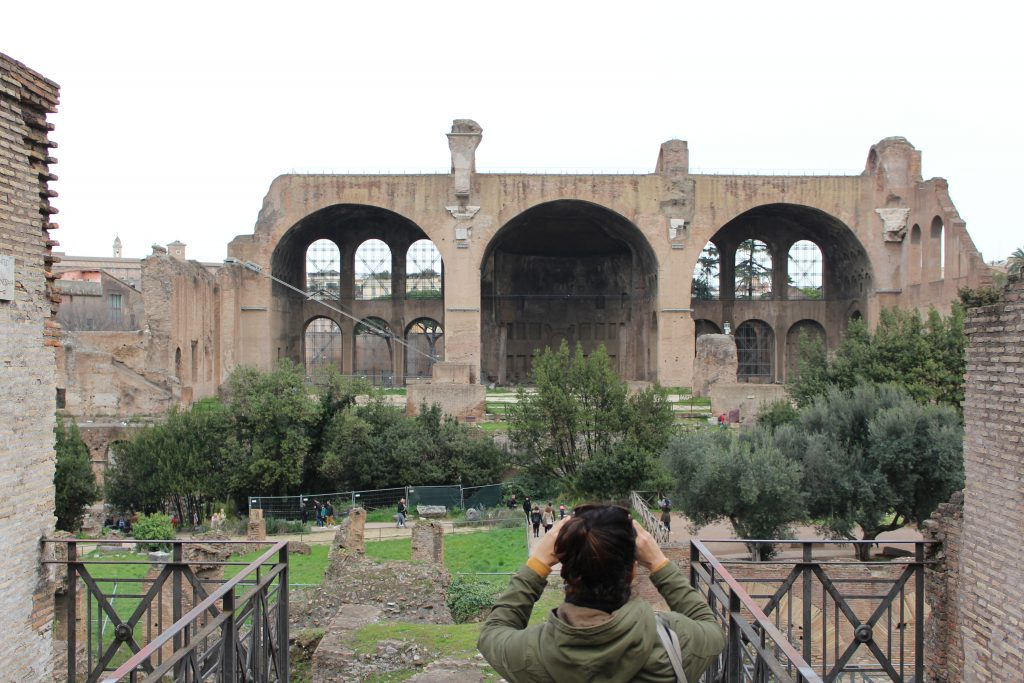 woman taking photo of Roman forum