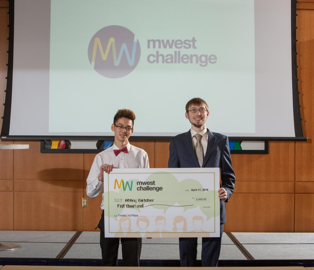 David Wang and Timothy Doorenbos receive check from MWest Challenge.