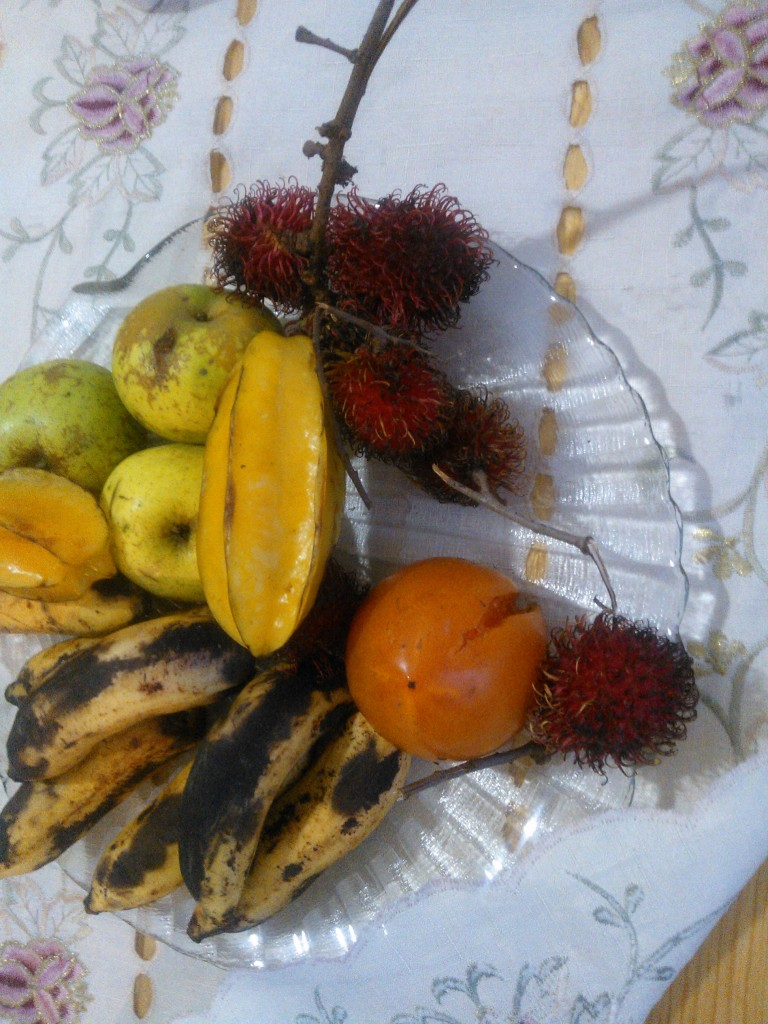 My host mom has been introducing me to new fruit - such as these spiny litchis and yellow star shaped karambola :)