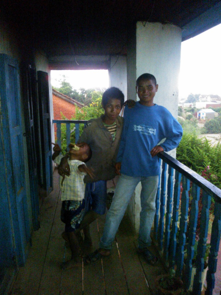 A host cousin and one of the farm workers who lived at our house and my host brother